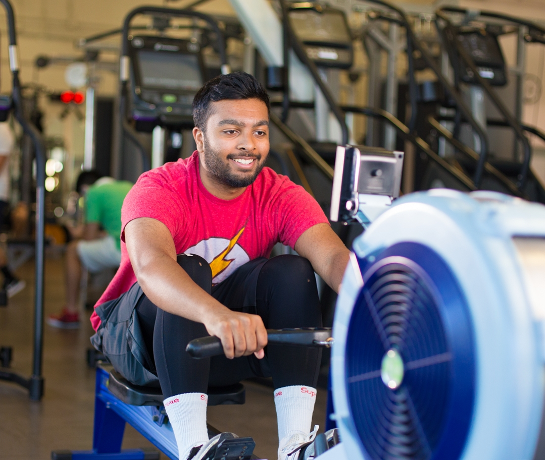 Man smiling on the rowing machine