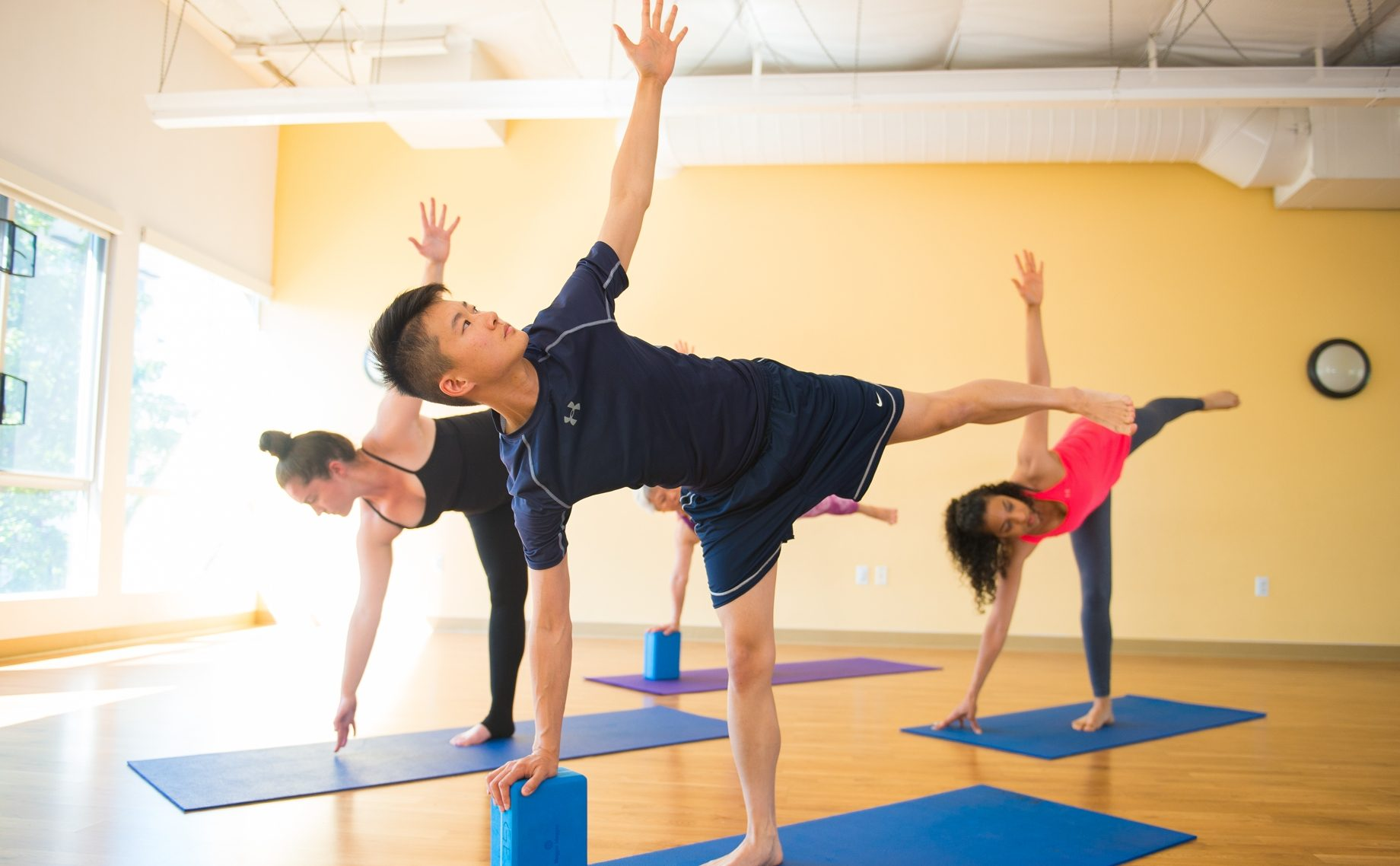 Young adults doing yoga