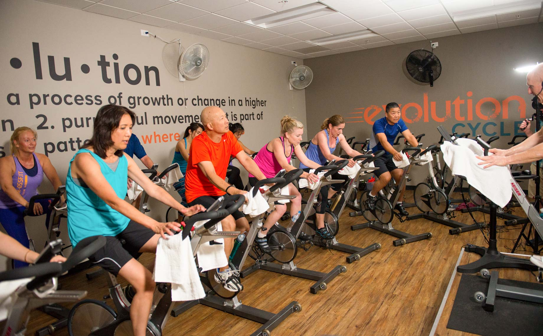 People cycling during an Evolution Cycle class