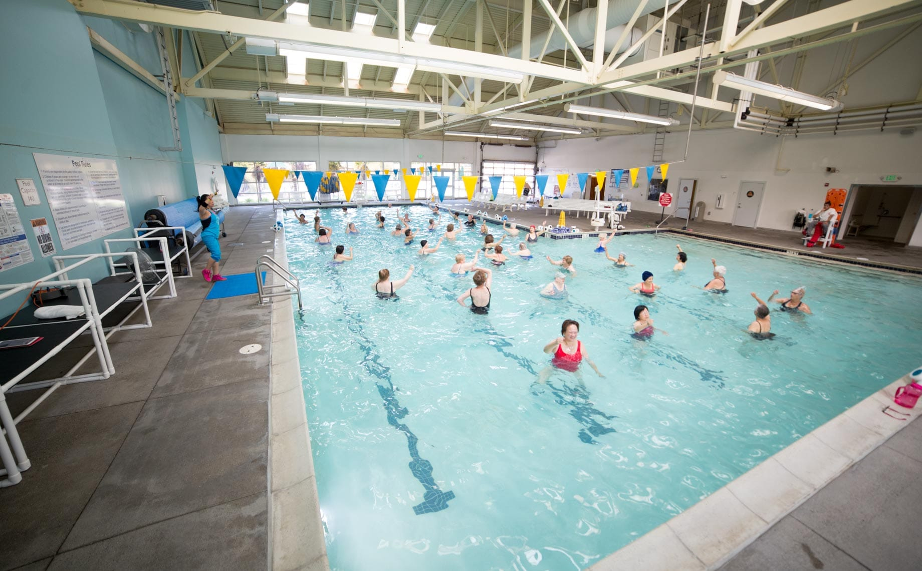 Women in a pool exercise class indoors
