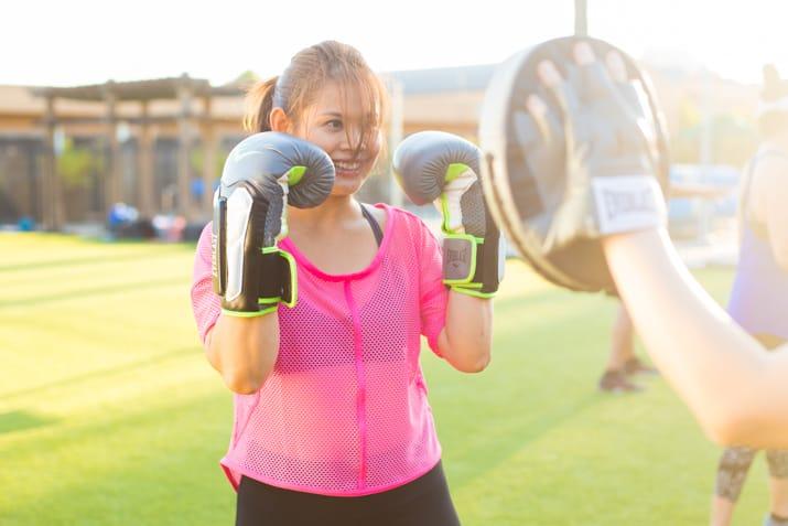 Woman wearing pink kickboxing outdoors