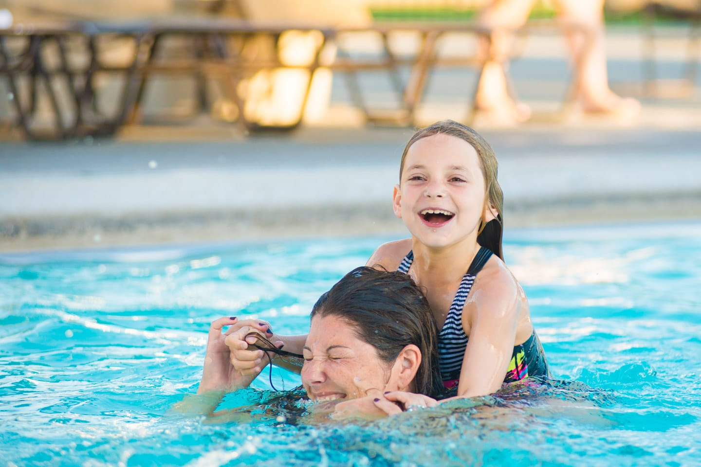 Mother and daughter playing in the PJCC outdoor pool