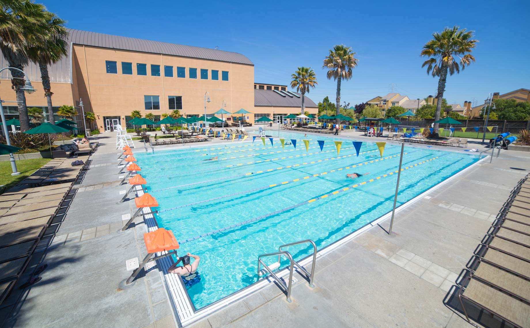 PJCC outdoor pool with adult swimming in lanes
