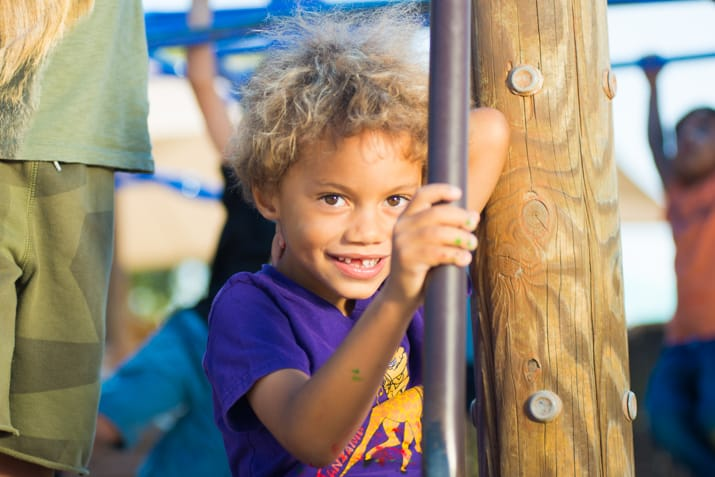 Young boy on the PJCC playground smiling