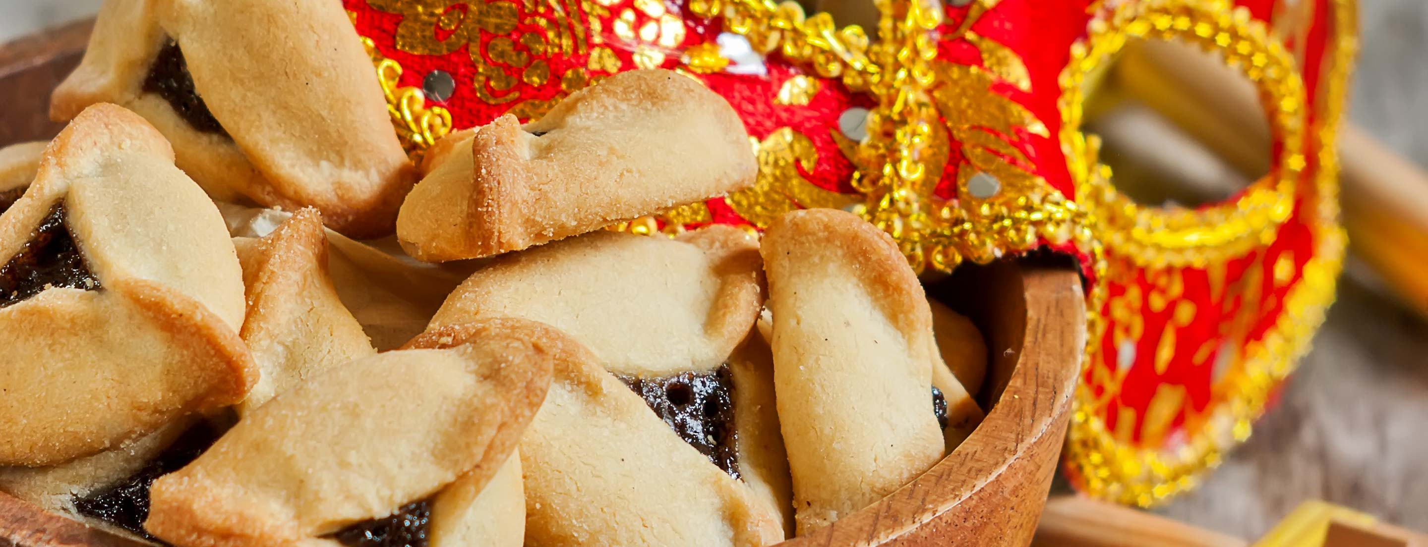 Learn about the Jewish holiday of Purim from the Book of Esther Includes a recipe for hamentaschen traditional holiday cookies