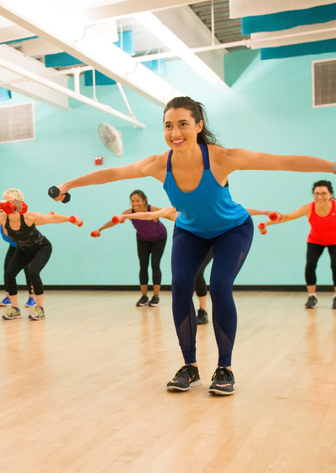 Woman participating in a group class in a gymnasium