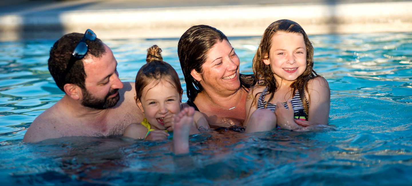 Family together in a swimming pool