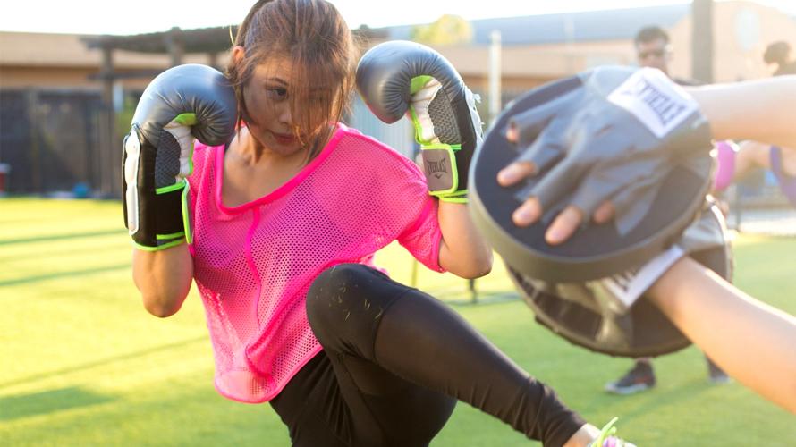 Young girl kickboxing